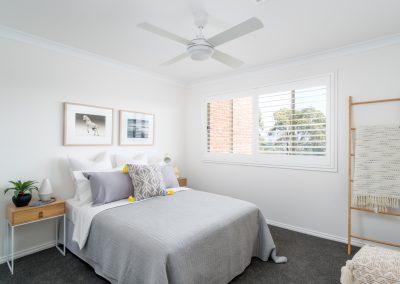 Bedroom styled in tones of grey
