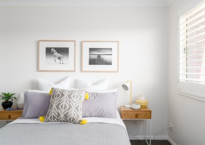 Symmetrical artworks create balance and order in this bedroom