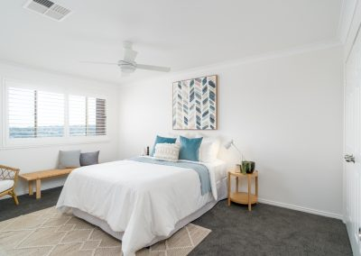 Restful tones of blue and white in a master bedroom