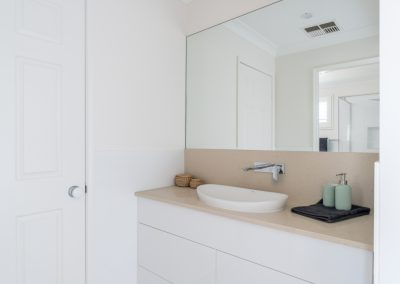 bathroom vanity top with towels and soap