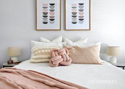 art creates a focal point in a bedroom